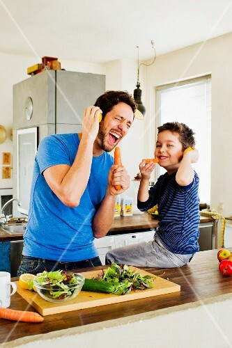 A father and son with 'microphone' carrots