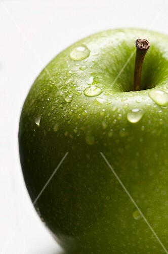 A freshly washed green apple