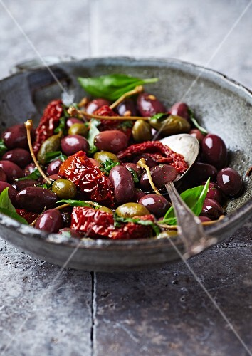 Marinated olives with dried tomatoes and capers