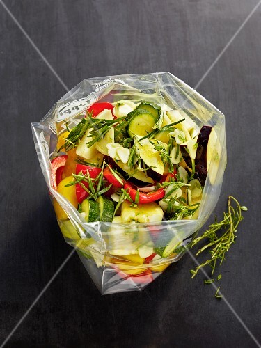 Ratatouille vegetables being marinated in a freezer bag