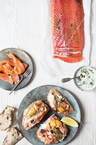A side of smoked salmon, smoked salmon strips and salmon served on bread