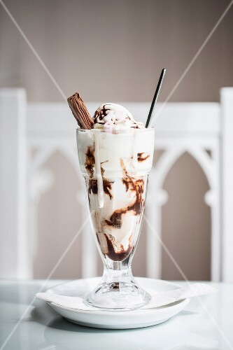 An ice cream sundae with chocolate sauce