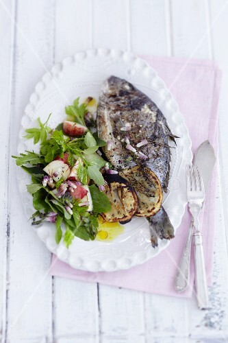 Grilled seabream with a wild herb salad