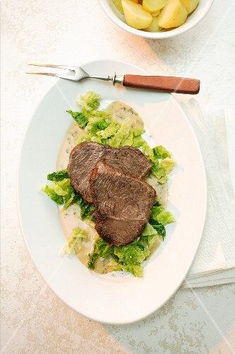Roast beef on a Savoy cabbage medley