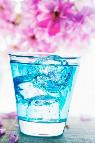 Blue Curacao drink with ice cubes