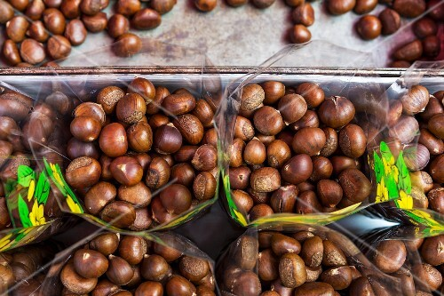 Edible chestnuts in plastic bags at a market in Thailand