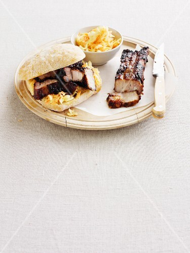 A spare rib sandwich with coleslaw