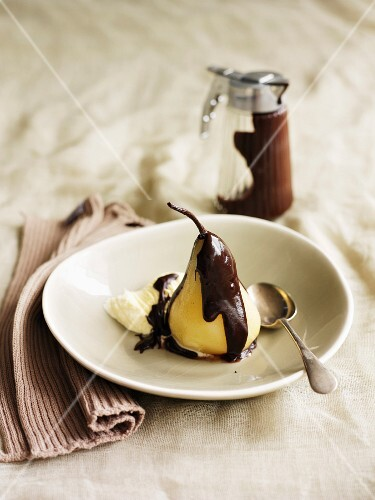 Poached Pear with Chocolate Sauce and a Scoop of Vanilla Ice Cream, Spoon