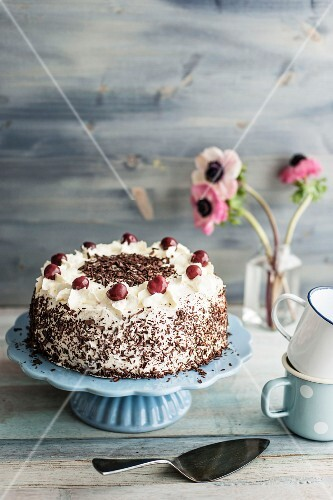 Black Forest Gateau on a light blue cake stand