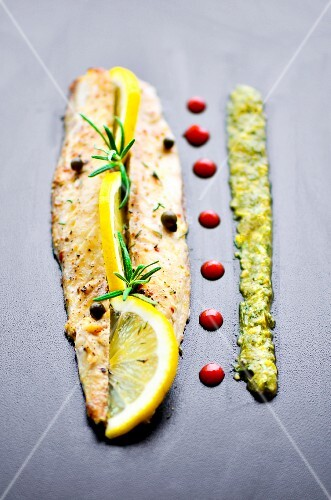 Grilled mackerel fillet with lemon, rosemary, salsa verde and pomegranate syrup
