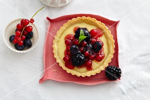 A tartlet with vanilla cream and mixed berries