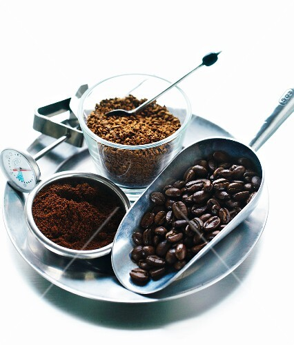 An arrangement of coffee beans, ground coffee and instant coffee