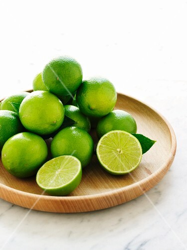 Limes on a wooden plate
