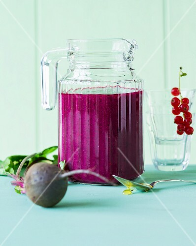 A smoothie made with beetroot, berries and orange