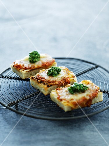 Slices of pizza with pesto