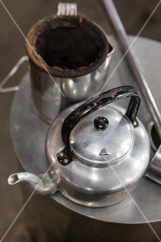 An old-fashioned kettle and a coffee filter (Thailand)