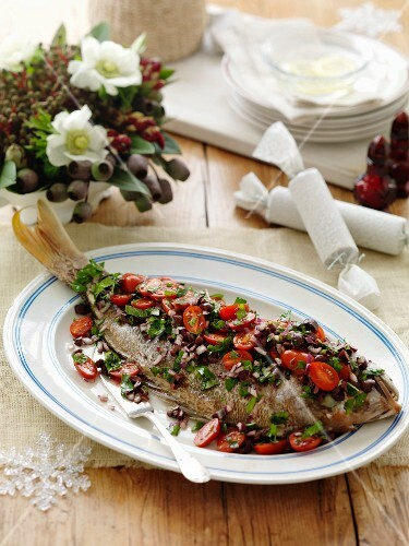Red snapper with olive and tomato salsa