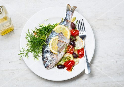 Sea bream with tomatoes and olives