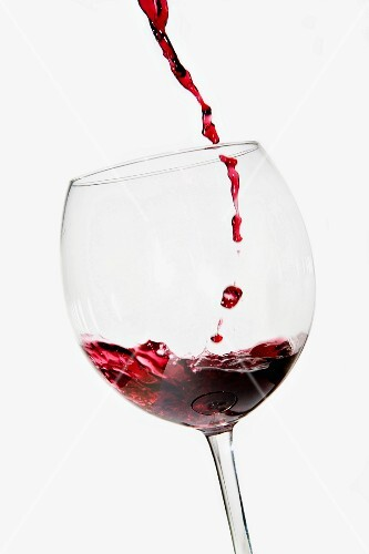 Red wine being poured into a glass