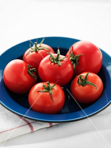 Tomatoes on a blue plate