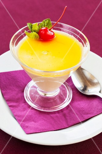 Passion fruit mousse dessert with a cocktail cherry