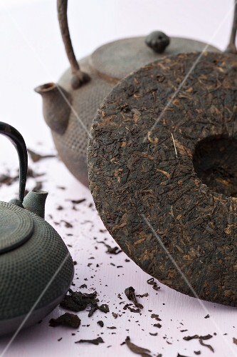 Chinese teapots and a pu-ehr tea cake