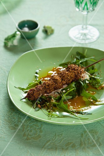 Beetroot skewers with a dukkah crust on a rocket salad