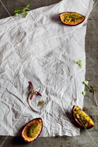 Parchment paper with a sliced passion fruit