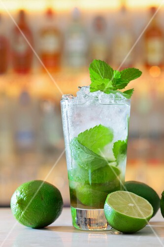 A Mojito with mint and lime in a bar