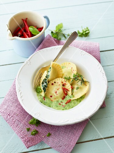 Ravioli with a spinach and ricotta filling and a chilli and herb sauce