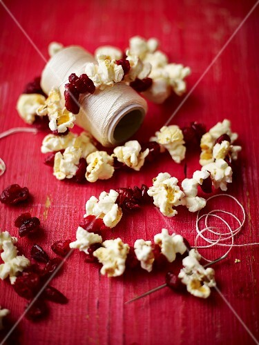 Popcorn and dried cranberries threaded onto string as Christmas decorations