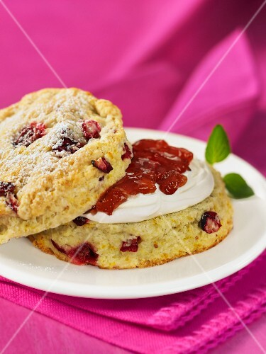 A cranberry scone topped with clotted cream