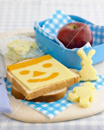 A snack for children with a funny cheese face