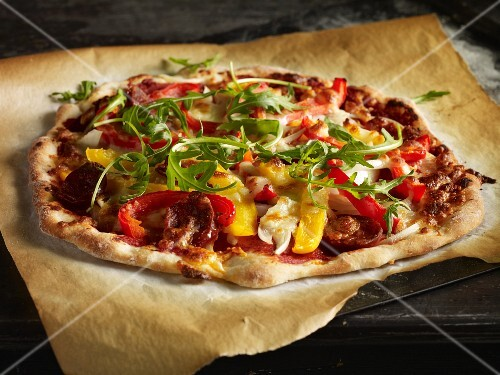 Homemade pizza with peppers, rocket and peperoni