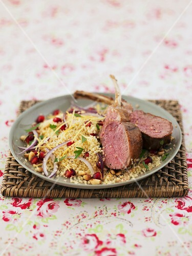 Lamb chops on a bed of couscous with pomegranate seeds and pine nuts