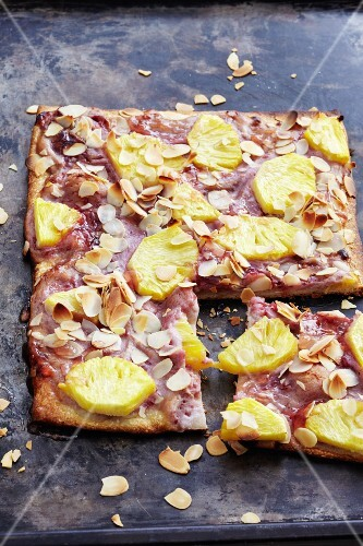 A sweet pizza topped with raspberries and pineapple