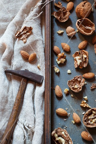 Cracked walnuts and almonds with a hammer