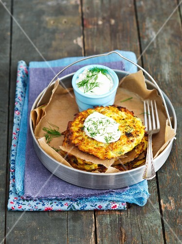 Yellow courgette fritters with sour cream and dill