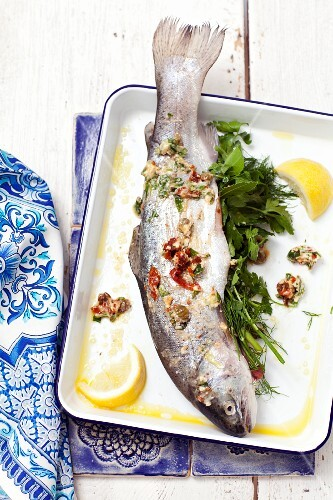Fresh trout with herbs, lemons and dried tomatoes