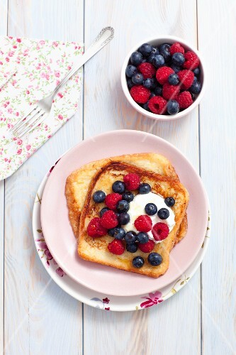 French toast with maple syrup, berries and yoghurt