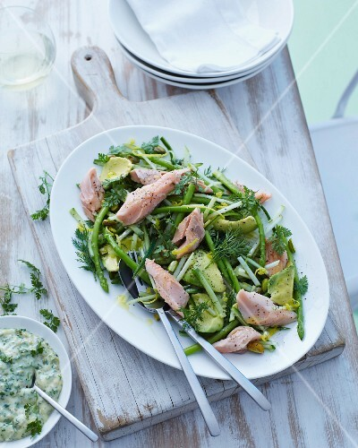 A salad made with green asparagus, avocado and smoked trout with dill