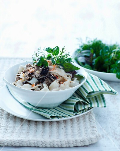 Wide rice noodles with pork and herbs