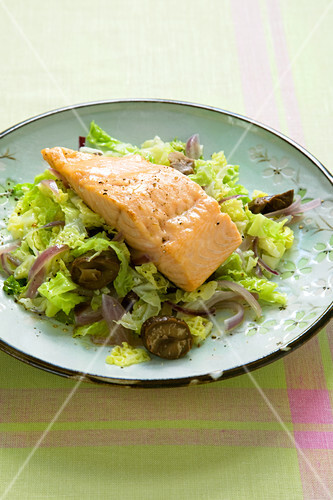 Grilled salmon on a bed of braised cabbage with chestnuts