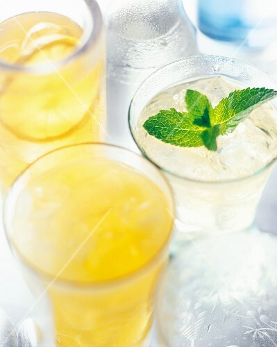 Summer cocktails made with lemon juice, ice cubes and mint