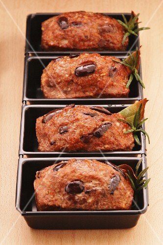 Individual meat loaves with olives and rosemary