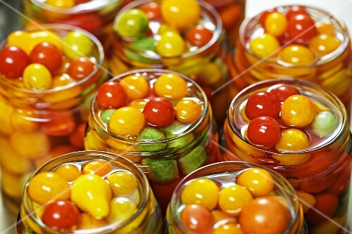 Tomatoes preserved in jars