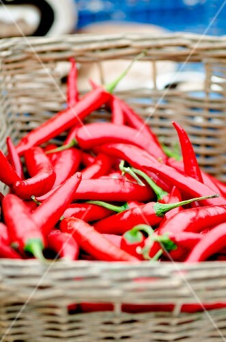 Fresh red chilli peppers in a wicker basket