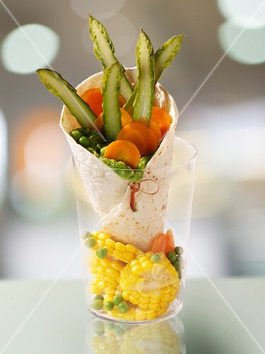 A tortilla wrap filled with vegetables and sweetcorn