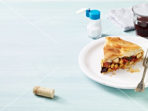 A slice of puff pastry strudel with tofu and vegetables