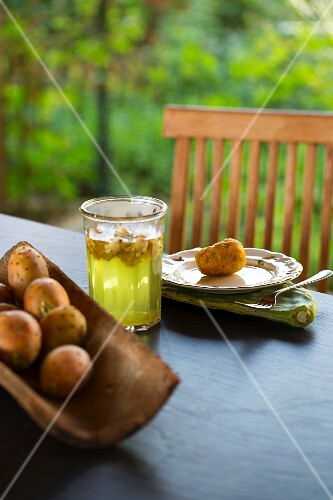 Cactus figs and tea on a garden table
